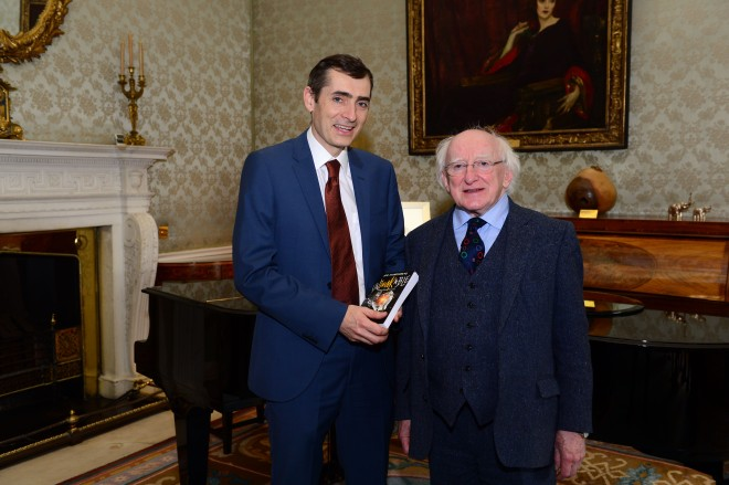 President Michael D Higgins is presented with a copy of the book 'Unthinkable; Great Ideas for Now' by Joe Humphreys at Aras an Uachtarain.